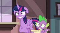 Twilight Sparkle grinning nervously at her friends S6E22