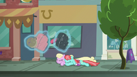 Manehattanite ponies duck under Rarity's luggage S8E4