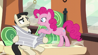 Pinkie pushes Don Draper pony's newspaper down S5E11