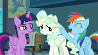 Rainbow Dash raising a hoof in triumph S6E24