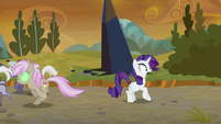 Rarity sees Sombrafied ponies charging at her S9E2
