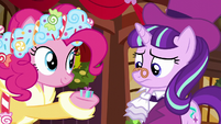Spirit of HW Presents holding small-sized present S6E8