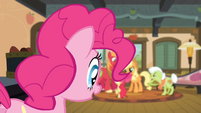 Pinkie looking at the Apples arguing S4E09