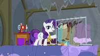 Rarity next to a rack of costumes S8E7