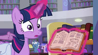 Spike tapping on Twilight's shoulder S9E5