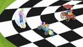 Crusaders' carts racing on a checkered flag S6E14.png