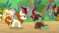 Dark-red Kirin shaking her head S8E23