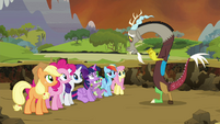 Discord showing the medallion to his friends S4E26