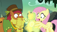 Meadowbrook's mask glows in Fluttershy's wing S7E25