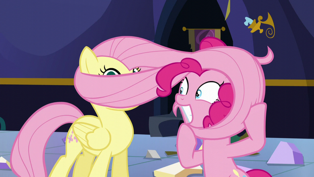 File:Pinkie wraps Fluttershy's mane around her head S5E11.png