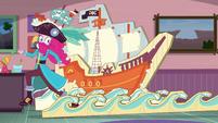 Pirate Pinkie placing cardboard waves of water EGDS3