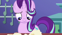 Starlight looks at her ruined teacakes S7E2