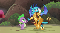 Ember lightly shaking Spike's finger S6E5