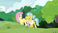 Fluttershy leads Dr. Fauna back to the meadow S7E5.png