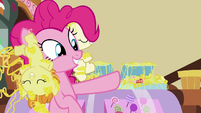 Pinkie Pie pointing at cupcakes behind her S7E19