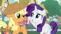 Rarity knocks Applejack's hat slightly askew S7E9