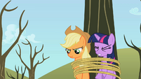 Applejack and Twilight tied to the tree S2E10
