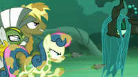 Coco Crusoe and Sweetie Drops pointing their spears to Chrysalis S5E26