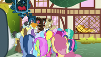 Davenport addresses a crowd outside his store S7E19