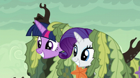 Twilight and Rarity poke their heads out of the seaweed S6E5