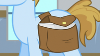 Worksheets in male student's saddlebag S8E16