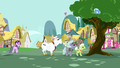Angry ponies chase Trixie up a tree S7E2.png
