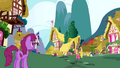Berryshine along with other ponies walking around Ponyville S1E01.png