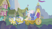 Celestia and Luna ride a chariot into Ponyville S1E02