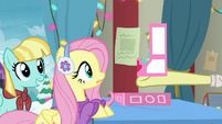 Flim giving a Holly the Hearth Warmer doll to Fluttershy MLPBGE