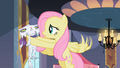 Fluttershy holding Opalescence S2E9.png