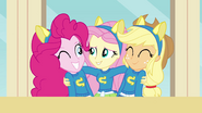 Fluttershy hugging Pinkie and Applejack EG