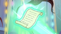 Starlight's magic wraps around the scroll S7E24