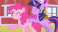 Twilight and Pinkie forming a conga line S1E25