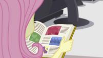 Yearbook in Fluttershy's hands EGFF