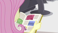 Yearbook in Fluttershy's hands EGFF