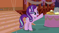 Starlight Glimmer waves to friends on the hill S8E3