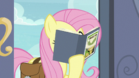 Fluttershy reading a Daring Do book S9E21