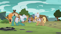 Green MH pony points spear at brown MH pony S7E16