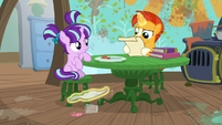 Sunburst cleans spill while reading spell scroll S6E1