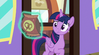 Twilight looks skeptical at bag of pretzels S7E2