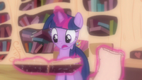 Twilight skimming pages S3E13