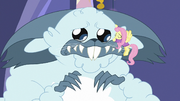 Fluttershy gives winterzilla a comforting hug MLPBGE