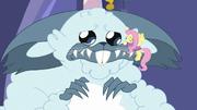 Fluttershy gives winterzilla a comforting hug MLPBGE
