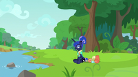 Luna resting her hooves by a river S9E13