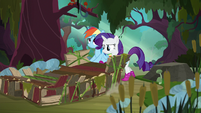 Rainbow and Rarity pushing the raft S8E17