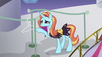 Sassy Saddles looking at empty wire hanger S5E14
