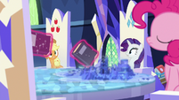 Books float past Applejack, Rarity, and Pinkie S7E25
