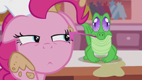 Gummy licking the cream off of Pinkie's face S5E8