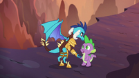 Princess Ember carries Spike to safety S6E5