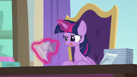 Twilight elaborately folding a napkin S9E20